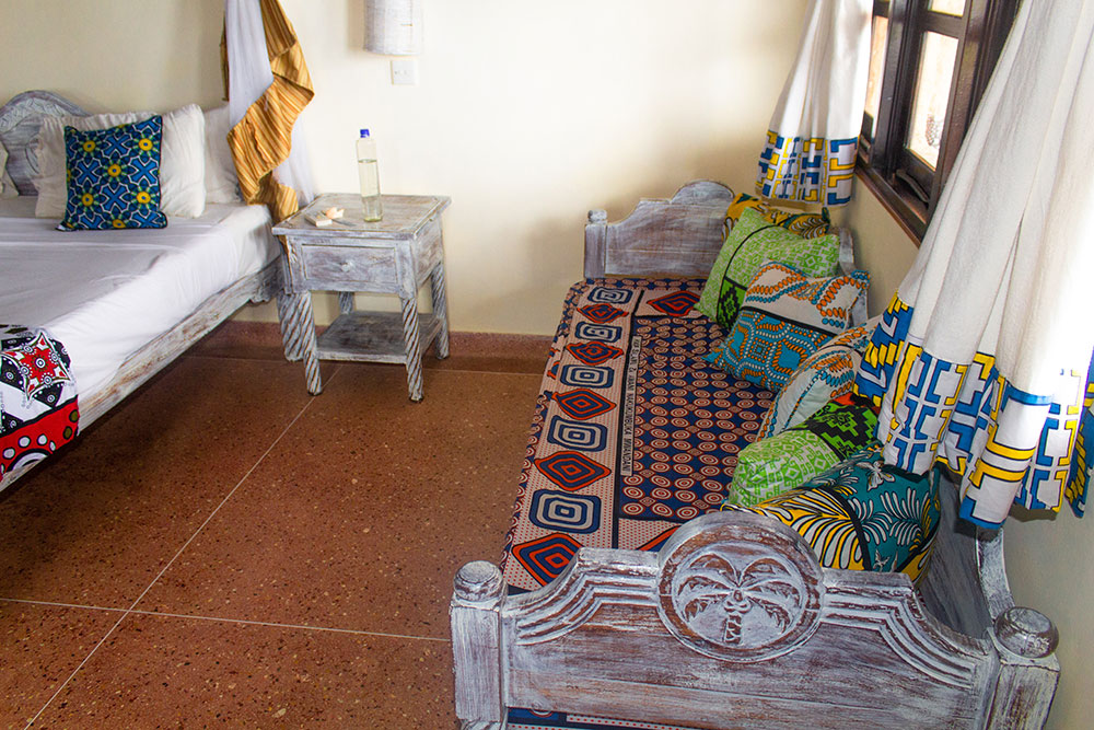Swahili bed inside the standard room at Chale Island